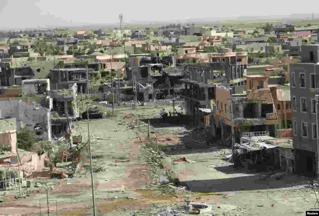 A general view shows damaged houses after fighting in the city of Ramadi, Iraq, June 19, 2014.