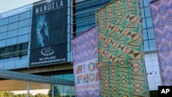 "In this Oct. 10, 2017 photo, fabric banners stand in front of the Clinton Presidential Center in Little Rock, Ark. The Clinton Library is presenting ""Mandela: The Journey to Ubuntu"" and ""Art of Africa: One Continent, Limitless Vision"" until February."