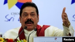 FILE - Sri Lankan President Mahinda Rajapaksa in Colombo, Nov. 17, 2013.
