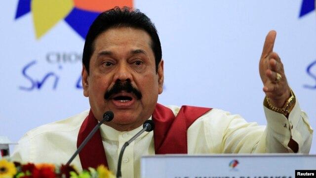 FILE - Sri Lankan President Mahinda Rajapaksa  in Colombo, Nov. 17, 2013.