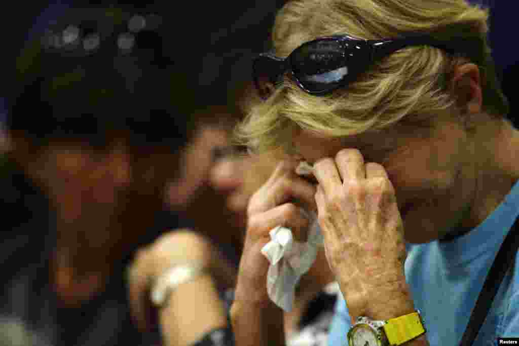 Toni Tennille cries as she listens to Arizona Governor Jan Brewer speak during a news conference at Prescott High School, July 1, 2013.
