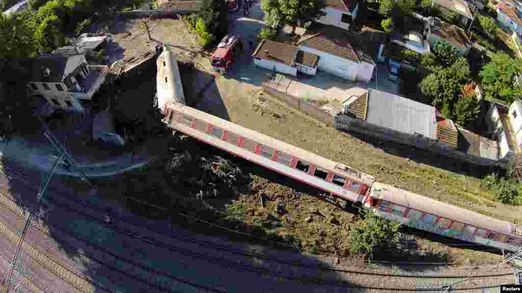 A train has toppled on its side after derailing and crashing into a house in the town of Adendro in northern Greece.