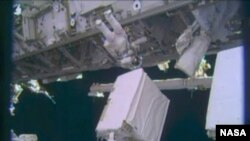 Astronauts Fix Pump at the International Space Station