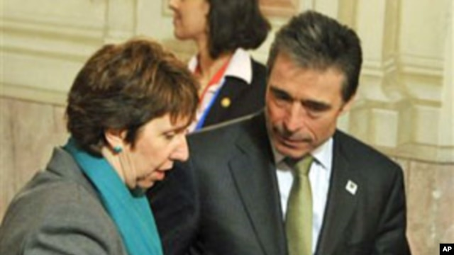 European Union foreign policy chief Catherine Ashton and NATO Secretary-General Anders Fogh Rasmussen during the informal meeting of EU Defense Ministers in Godollo, Hungary,  February 25, 2011