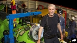 Film director James Cameron with small submarine before visit to Mariana Trench.