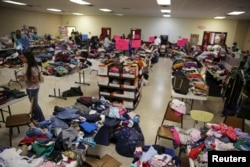FILE - A general view shows the Sacred Heart Catholic Church temporary migrant shelter in McAllen, Texas, June 27, 2014.