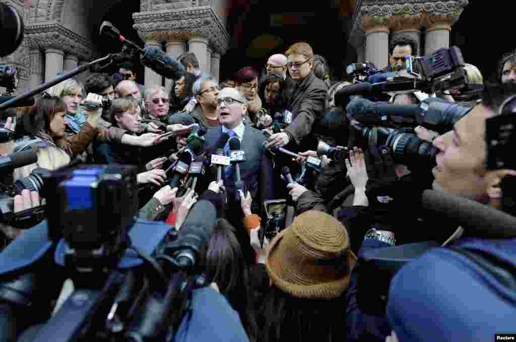 John Norris (C), the lawyer of suspect Raed Jaser, speaks to the media outside Old City Hall Court, following his client's brief appearance in court in Toronto. Two men charged in Canada with plotting an attack on a passenger train will appear in court for bail hearings, while questions swirl about their background and reported links to al Qaeda elements in Iran.