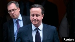 FILE - Britain's Prime Minister David Cameron leaves 10 Downing Street in London, Nov. 26, 2015.