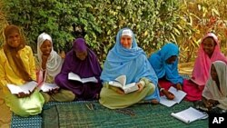 Maryam Kabeer Faye, here in 2009, teaching Arabic to students in Gambia