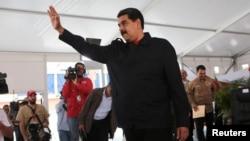 Venezuela's President Nicolas Maduro gestures during a meeting with supporters in Caracas, Venezuela, July 26, 2017.