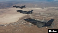 FILE - Three F-35 Joint Strike Fighters fly over Edwards Air Force Base in this Dec. 10, 2011, handout photo provided by Lockheed Martin.