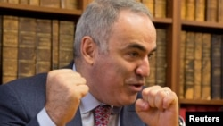 FILE - Former world chess champion and political activist Garry Kasparov attends a news conference in Paris, France, Oct. 16, 2014.