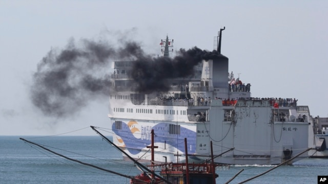 A ship carrying Chinese workers leaves Vung Ang port, Ha Tinh province, Vietnam, May 19, 2014.