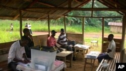 Members of the election commission of the polling station of Atout near Medouneu, Gabon, wait for electors during the legislative elections on December 17, 2011.