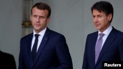 French President Emmanuel Macron accompanies Italian Prime Minister Giuseppe Conte after a meeting at the Elysee Palace in Paris, France, June 15, 2018.