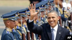 U.S. President Barack Obama waves to the media upon arrival Monday, April 28, 2014 at the Ninoy Aquino International Airport in Manila, Philippines.