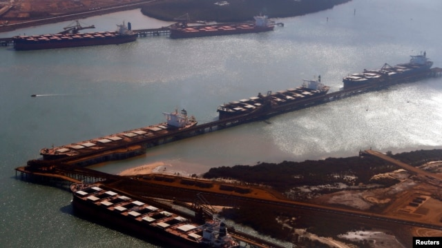 FILE - Ships waiting to be loaded with iron ore are seen at Port Hedland in the Pilbara region of Western Australia.