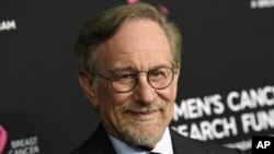 """FILE - Filmmaker Steven Spielberg poses at the 2019 """"An Unforgettable Evening"""" benefiting the Women's Cancer Research Fund in Beverly Hills, Calif. on Feb. 28, 2019. (Photo by Chris Pizzello/Invision/AP, File)"""