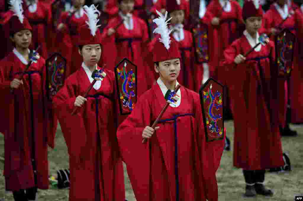 Students perform during an annual ritual ceremony to celebrate the Chinese philosopher and teacher Confucius' birthday at Sungkyunkwan University in Seoul, South Korea.