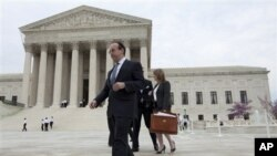 Lawyer walks down steps of US Supreme Court in Washington D.C. (2011 file photo)