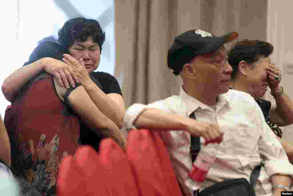 Relatives of passengers on the ship that sank at the Jianli section of Yangtze River in Hubei province, cry as they wait for news at a hotel, in Nanjing, Jiangsu province, China, June 2, 2015.