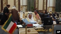Kuwait's Emir Sheikh Sabah al-Ahmad Al-Sabah reads a statement during the opening session of the 23rd Arab League summit in Baghdad, Iraq, March 29, 2012.