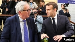 France's President Emmanuel Macron, right, and President of the European Commission Jean-Claude Juncker speak during the informal meeting of European Union leaders in Sibiu, Romania, May 9, 2019.
