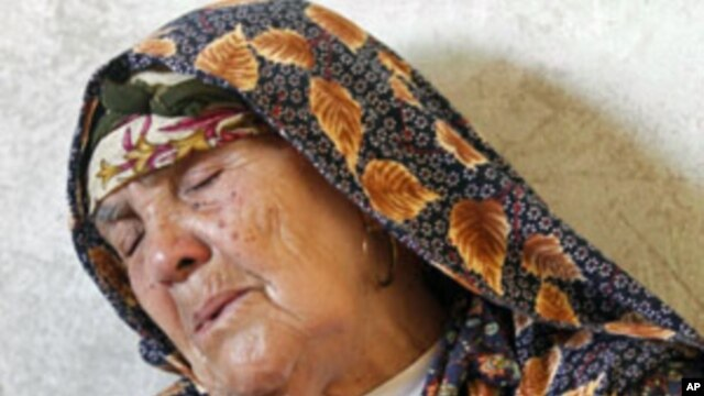 A woman mourns for her grandson Oussama Achour, a rebel fighter killed during a battle with forces loyal to Moammar Gadhafi at Misrata's western front line, May 31, 2011