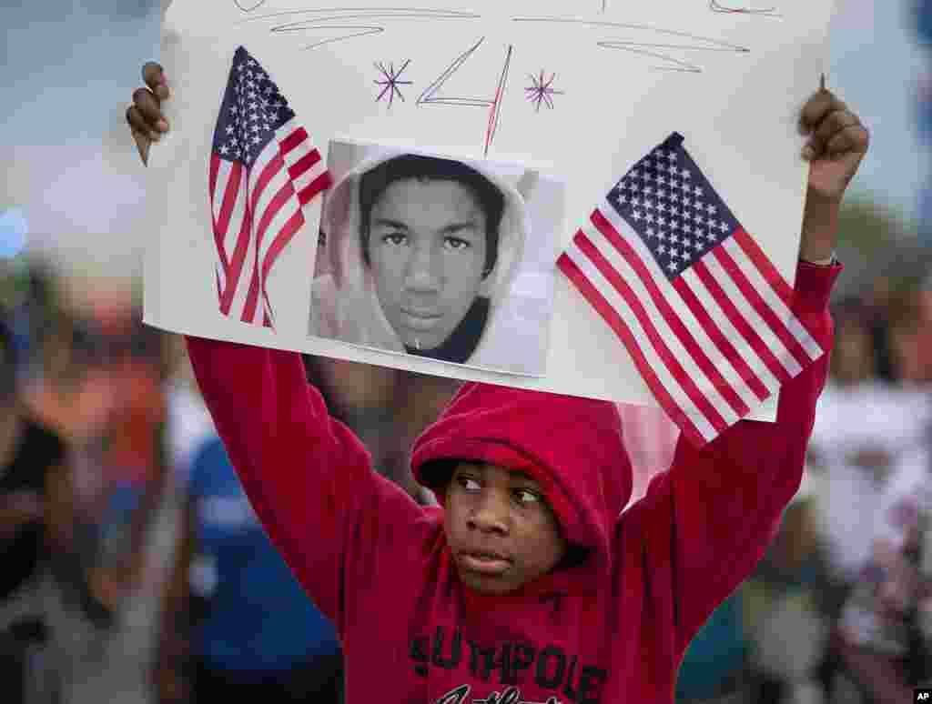 Jaylen Reese, 12, of Atlanta, marches during a protest of George Zimmerman's not guilty verdict in the 2012 shooting death of teenager Trayvon Martin, Atlanta, Georgia, July 15, 2013.
