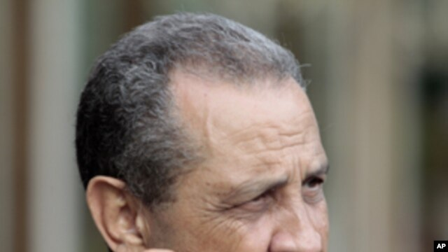 Former Libyan oil chief Shukri Ghanem talks with reporters in Rome, in this Wednesday, June 1, 2011 file photo.