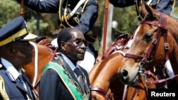 FILE - Zimbabwe's President Robert Mugabe arrives for the opening of Parliament in Harare, Zimbabwe, Oct. 6, 2016.