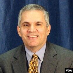 路易斯维尔大学布兰代斯法学院教授撒姆·马科森(Sam Marcosson)