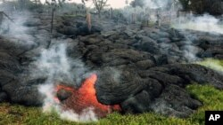 This photo provided by the U.S. Geological Survey shows the lava flow front of from an eruption that began the June 27, as the front remains active and continues to advance towards the northeast threatening the town of Pahoa on Hawaii's Big Island, Oct. 26, 2014.