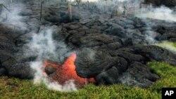 Lahar letusan Gunung Kilauea mengancam warga di kota Pahoa di Hawaii (26/10).
