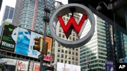FILE - The logo for the W Hotel, owned by Starwood Hotels & Resorts Worldwide, is seen in New York's Times Square, July 31, 2013. Starwood Hotels and Resorts is to sign a deal with Cuba since the country's 1959 revolution when Fidel Castro overthrew the island's U.S.-backed government.