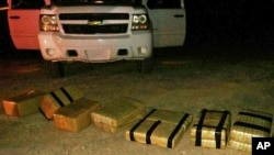 FILE - U.S. Customs and Border Protection displays an intercepted shipment of drugs that was brought into the U.S. from Mexico, near Yuma, Arizona.