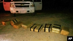 FILE - U.S. Customs and Border Protection displays an intercepted shipment of marijuana that was brought into the U.S. from Mexico, near Yuma, Arizona.