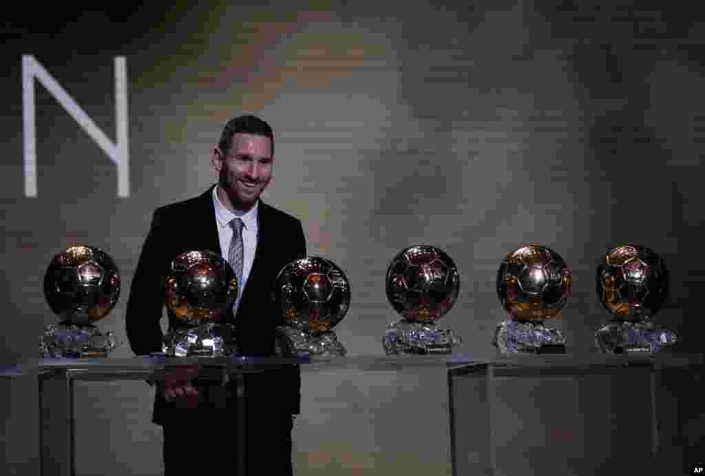 Barcelona's soccer player Lionel Messi poses with his six golden balls during the Golden Ball award ceremony in Paris, France, Dec. 2, 2019.
