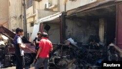 Bağdat'ta bomba yüklü araçla düzenlenen bombalı saldırılardan biri