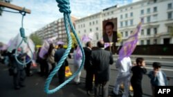 FILE - Mock nooses are displayed as supporters of the People's Mojahedin Organization of Iran (PMOI) take part in a demonstration outside the Iranian embassy in west London on July 31, 2010.