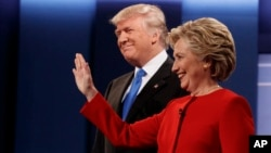 Republican presidential candidate Donald Trump, left, stands with Democratic presidential candidate Hillary Clinton before the first presidential debate at Hofstra University, Sept. 26, 2016, in Hempstead, New York.