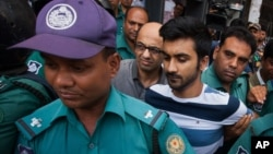 British national Hasnat Karim, center left, and University of Toronto student Tahmid Hasib Khan, center right, are taken before court in Dhaka, Bangladesh, Aug. 4, 2016.