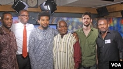 David Vendy (center) poses with members of Tosin and Afrikan Rhapsody in VOA studio.