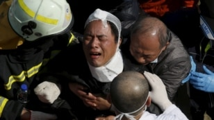 A relative cries after his family member was confirmed dead at a 17-storey apartment building that collapsed after an earthquake hit Tainan, southern Taiwan, Feb. 7, 2016.