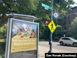 An advertisement promoting vaccinations in schools at a bus stop in Washington, D.C. July 26, 2021. (Dan Novak)