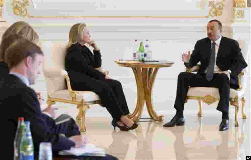 Azeri President Ilham Aliyev, right, and US Secretary of State Hillary Rodham Clinton meet at the presidential Zagulba residence in Baku, Azerbaijan on Wednesday June 6, 2012. Clinton has embarked on a tour of the South Caucasus in the hope of mediating p
