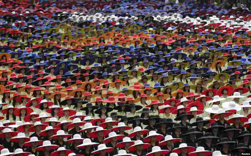 Participants in coordinated colors take part during Taiwan's National Day celebrations in front of the Presidential Office in Taipei. This year marks the 102nd anniversary of the founding of the Republic of China.