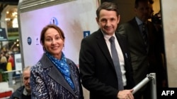 "French Environment Minister Segolene Royal and Junior Minister for State Reform Thierry Mandon attend the inauguration of the ""train du climat"" (climate train) in Paris, Oct. 6, 2015."