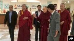 Tibetan spiritual leader, the Dalai Lama, center, leaves Max Hospital, in New Delhi, India, April 12, 2019.