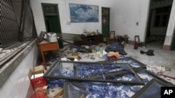 A damaged room in a residential building is seen after several locations were targeted with parcel bombs in the southwestern city of Liucheng, Guangxi province, Sept. 30, 2015.
